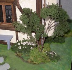 New England Miniatures Blog: Miniature Landscaping part II - hot glue reindeer moss clumps onto a found branch or twig