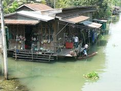 Traditional Thai House on a river canal in Bangkok Thailand
