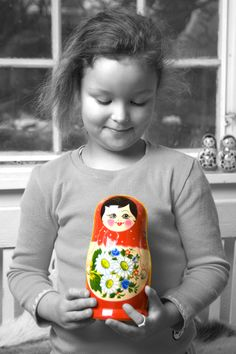 Johanne with a coral red nesting doll from Babushka - www.babushka.nu