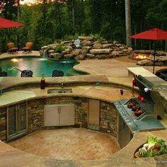 Outdoor grilling area that's a few feet below the pool area gives the cook a straight shot to see party guests.