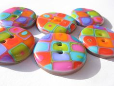 a few more buttonד I made from the colorful retro cane by orly rabinowitz, via Flickr