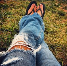 Nothin better than sitting in a field on a beautiful day! Holy jeans & flip flops, my favorite!