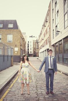 Groom outfit, blue grey hipster, and her dress is cute. Not a wedding dress tho