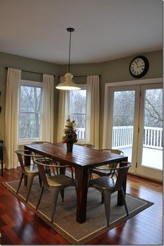 Rustic kitchen table, metal chairs, cool light fixture