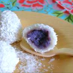 Ube-Coconut Rice Balls makes about 20  small purple sweet potato (about 6 ounces) 1 1/2 cups glutinous rice flour 1/2 cup lukewarm water (or more as needed) 1 cup dessicated coconut sugar to taste  1. Roast ube in preheated 425F degree oven for 30-35 minutes or until soft to touch. Let cool, scoop out of the skin and mash with fork.  2. In a medium saucepan, fill halfway with water and put to boil over high heat.  3. Meanwhile In a medium bowl, place rice flour. Stir in water and mix…