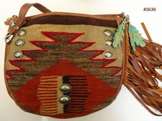 Large Saddle Bag made of fine leather and fragment of vintage Navajo rugs.  Produced in U.S.A.  Find more designer handbags at www.pccohandbags.com