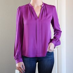 DVF purple silk blouse 6 Gorgeous purple/magenta Diane Von Furstenberg top. 95% silk, 5% spandex. Worn a couple times and freshly dry cleaned. Long sleeves. The top has a closure by the neck, so you can wear it open, or closed and have a cutout in the chest. Very pretty and classy top! Diane von Furstenberg Tops Blouses