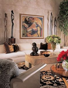 home accessories living room A Wayne Forte canvas hangs in the living room. John Widdicomb end table. Ethnic Living Room, African Living Rooms, African Room, African Themed Living Room, Ethnic Home Decor, African Home Decor, African Interior Design, Decor Interior Design, Design Design