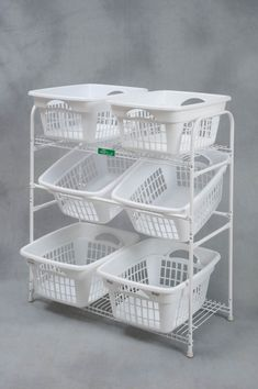 Basket Buddy is an all steel construction with a durable, white powder coat finish. It's designed for maximum visibility and handling of contents. It comes in six different modules and is fully customizable with additional . Laundry Basket Holder, Laundry Basket Dresser, Laundry Basket Storage, Stackable Laundry Baskets, Kitchen Organization Pantry, Home Office Organization, Organizing, Corner Storage, Hidden Storage