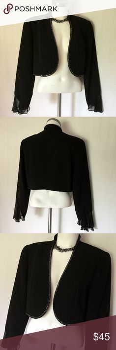 Junnie Leigh Black Evening Jacket 🎉 Junnie Leigh Black Cropped Evening Jacket with sparkley black bead accent. This short jacket would look great with a cocktail dress, evening gown,  or chic over a bandeau 😍 In Excellent Condition, no rips, snags, tears, or stains Junnie Leigh Jackets & Coats