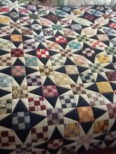 "This wonderful quilt was pieced by my Mother in Law, and quilted by her Quilting Bee in Graham, Texas.  It was an exchange block of 3"" nine patches, and she made this great star quilt by adding a simple triangle patch.  Amazing!  What a treasure."