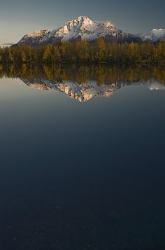 Scenic View Of Pioneer Peak Reflecting In Echo Lake At Sunset, Southcentral, Alaska