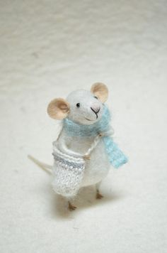 I love the adorable, sweet expressions on these little mice! What a fun Christmas tree decoration. Or have him peeping out from behind some books or pottery on a shelf :-) Little Traveler Mouse unique needle felted by feltingdreams, $58.00