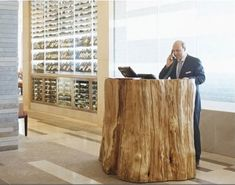 GOT TO LOVE THIS! reception desk #timber #log