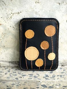 I don't have an iphone...but this would make a pretty cool wallet