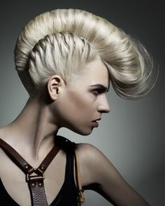 A long blonde straight coloured multi-tonal mohawk updo hairstyle by Rush