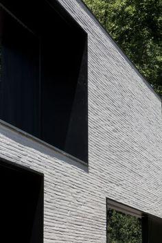 Fine bricks and metal surroundings around windows: