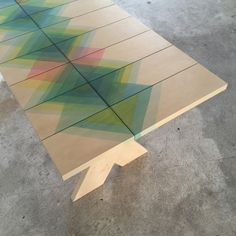 raw-edges-designboom- Dipped each wood panel in dye color