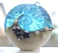 ❦ christinaguentherjewelry: ocean wave lampwork bead
