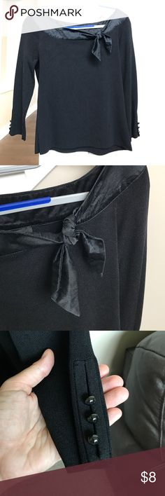 "Silk trim black top Great staple piece. 3/4 sleeves. Boat neck. Silk trim are neckline that ends in a jaunty little bow. In EUC. About 15"" armpit to armpit. 21"" from top of shoulder to bottom of hem. Cable & Gauge Tops"
