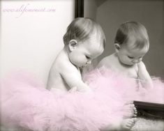 Baby in a tutu in a reflection. Love the in the mirror thing + the pose.