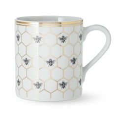 Equal parts elegant and eye-catching, our porcelain mugs showcase a squadron of bees amid graphic, architectural honeycomb. Detailed with gold, the collection layers beautifully with white porcelain dinnerware and serveware to create a welcomi… Porcelain Dinnerware, Porcelain Mugs, White Porcelain, Ceramic Coffee Cups, Coffee Mugs, Tea Cup Saucer, Tea Cups, Bee Images, Honeycomb Pattern