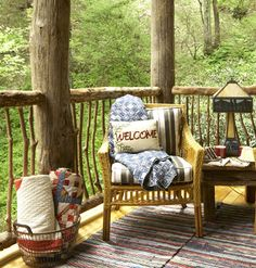 Listen In ~ Outdoor furniture rests comfortably on the back porch. This durable design blends with indoor decor, such as the Tiffany lamp and rag rugs made from recycled blue jeans. Quilts are at the ready for chilly evenings. Bedroom windows open onto this serene space to catch the sound of Whisper Creek.