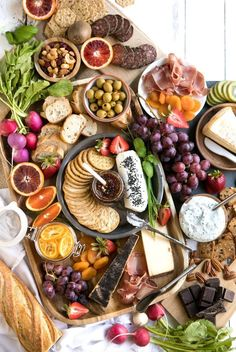 Colorful Spring Cheese Board Spring Cheese Board complete with colorful fruits, yummy cheeses, salty meats, carbs, chocolate and a delicious glass (or two) of wine Plateau Charcuterie, Charcuterie And Cheese Board, Charcuterie Platter, Cheese Boards, Party Food Platters, Cheese Platters, Serving Platters, Meat And Cheese, Goat Cheese