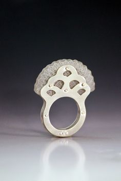 """Lace Fan Ring. .999 pure silver, """"Shrinky Dink"""" plastic stamped with Staz On ink. C2012 elmh. Photo by K. C. Uthus"""