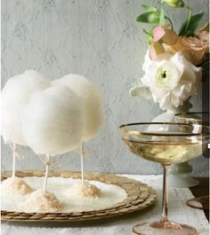 Love the mini bites of cotton candy served this way... And with the vintage champagne, it would be wonderful at an outdoor summer wedding ;). The Knot Magazine.