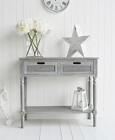 British Colonial Furniture Range - A grey console table. Grey and white furniture