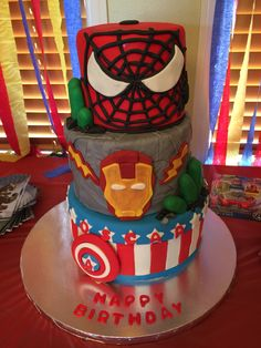 Super hero birthday cake.  Can you find all 4 super heroes depicted?