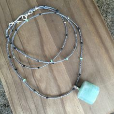 Aquamarine chunk pendant on grey (gray) braided, beaded cotton cord necklace by MiiMyxJewelry on Etsy https://www.etsy.com/listing/211850116/aquamarine-chunk-pendant-on-grey-gray