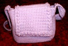 Really cute small bag, made with cotton & lengthened strap for cross body. It's a keeper