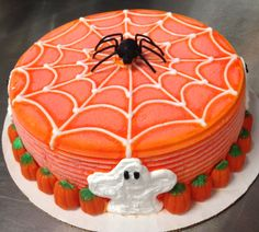 Dairy Queen ice cream cake with spiderweb, ghosts and candy pumpkins.