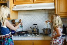 tori and stella in the kitchen with blue apron!