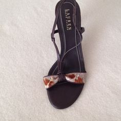 Ralph Lauren  Heel Sandals This  3 1/2 inch heel brown sandals by Ralph Lauren is very chic. With a thin strap  and Patterned strap across the toe this size 8 1/2B sandals is perfect for a Spring Fling. Ralph Lauren Shoes Sandals