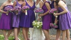 Different color purple bridesmaid dresses.