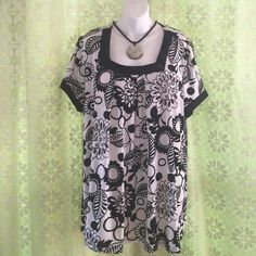Cato Woman Blouse EUC  Cato Woman blouse. Square neckline trimmed in black with decorative buttons. Short sleeves trimmed in black.  94% polyester 6% spandex. Cato Tops Blouses