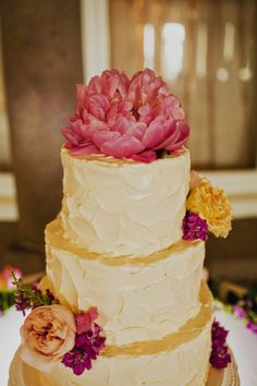 Buttercream Wedding Cake With Pink Flower Topper by Scrumptious | http://www.sloanphotographers.com/