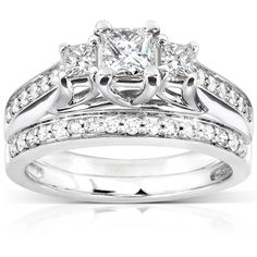 Show your love with this stunning wedding ring set with a total of 31 diamonds in two 14-karat white gold bands. Two .2-carat accents surround the engagement ring's .33-carat princess-cut center stone. Many .1-carat accents add sparkle to both bands.