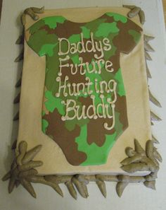 Camo Baby Shower Cake...the idea is cute...but the border sort of looks like dog poop lol
