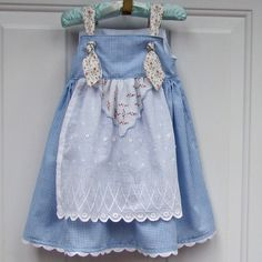I think I would put the knots in the back--use the tinkerbell hanky tip, over the white eyelet apron!