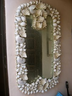 DIY Shell Mirrors= I just love Shell mirrors I think everyone needs at least one this one is quite pretty.