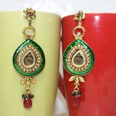 Temple shape earrings in theva and meenakari work