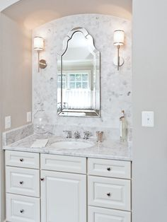 the best gray paint colour to go with marble countertops and white cabinets.  Review of Revere Pewter by benjamin moore