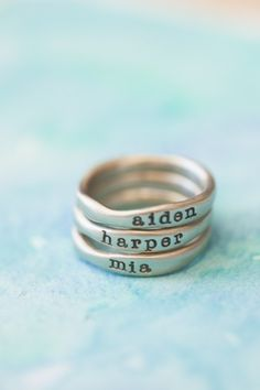 Hand-molded and cast in 10k white gold, these rings have a beautiful organic shape and feel. Each ring has a hammered texture. Customize your ring with a special name or short phrase and stack them up for an up-to-date look!