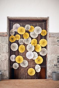 paper pinwheels hanging- @Katie Corkle you can do this and it wouldn't require hanging on a wall.