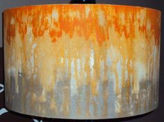 This beautiful lampshade is made of hand painted canvas. It was painted using a drip technique. This particular shade is painted with orange