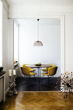 Canary upholstery in a minimal dining room, love